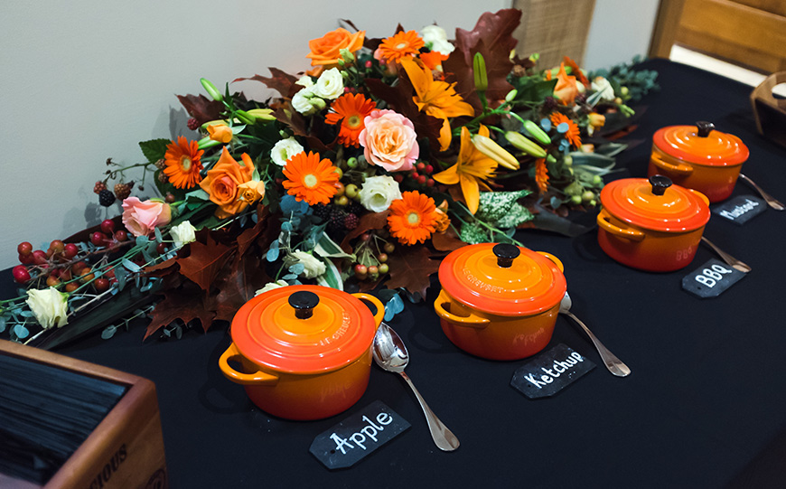 What To Look For In An Autumn Wedding Venue - Orange pots with flowers | CHWV