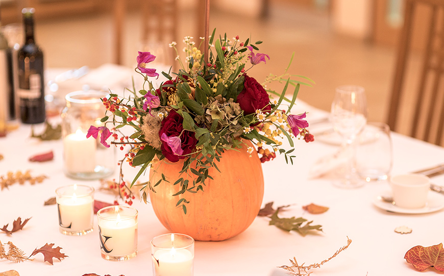 What To Look For In An Autumn Wedding Venue - Flowers pumpkin candle decor | CHWV