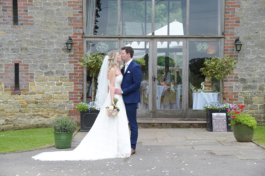 Claudia and Mark's real life wedding at Bartholomew Barn - Kissing | CHWV
