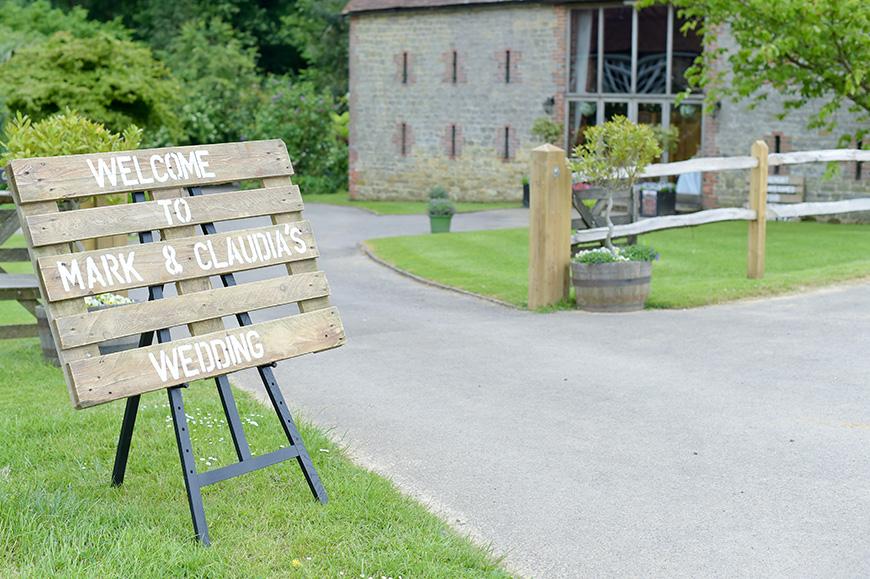 Claudia and Mark's real life wedding at Bartholomew Barn - Sign | CHWV
