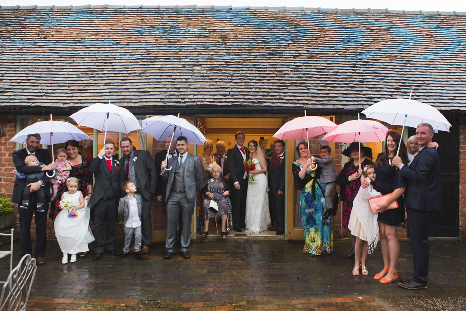 Quirky red wedding at Curradine Barns © Olivia Photography - Embracing the rain
