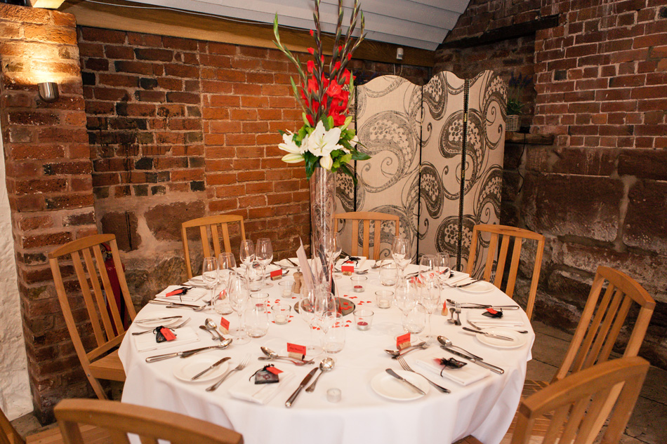 Quirky red wedding at Curradine Barns © Olivia Photography - Flower Table Centrepieces