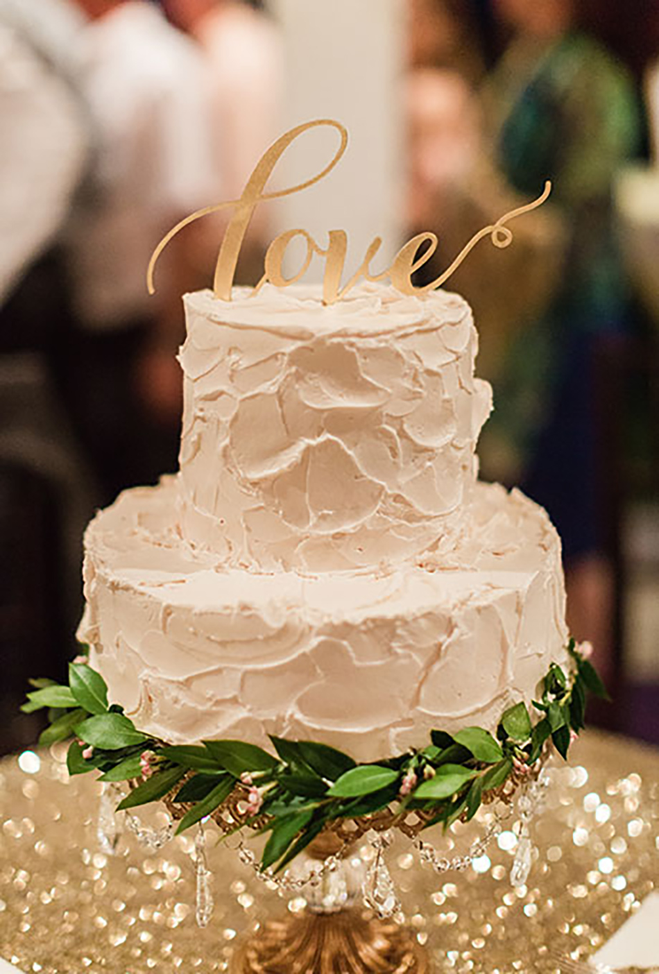 Bling up your barn wedding venue with sparkling metallic wedding cake accessories