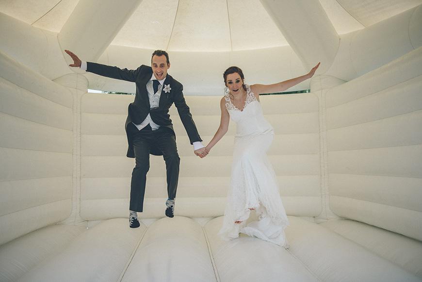 Real Wedding - Hazel and Chris' DIY Barn Wedding at Mythe Barn - Bouncy castle | CHWV