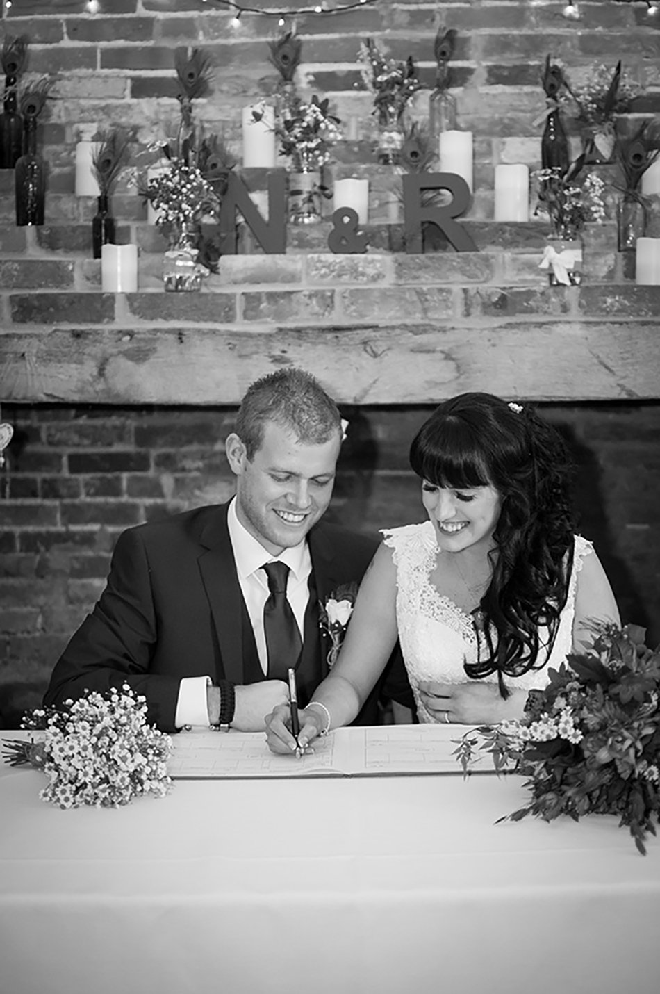 A peacock feather-themed wedding at Clock Barn