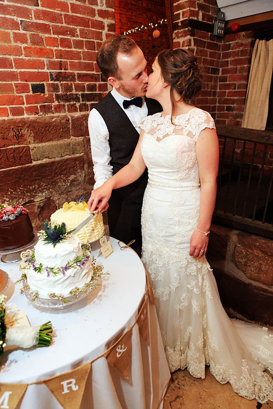Sophie and James real life wedding at Curradine Barns - Cutting the cake   CHWV