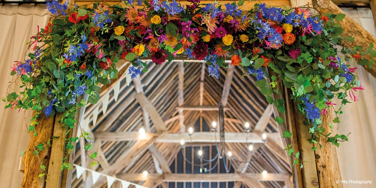 Becca and Michael's Colourful Wedding at Clock Barn | CHWV