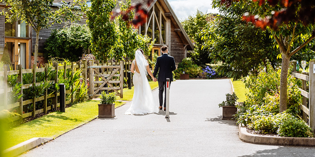 A happy couple taking a moment at Mythe Barn wedding venue in Leicestershire | CHWV