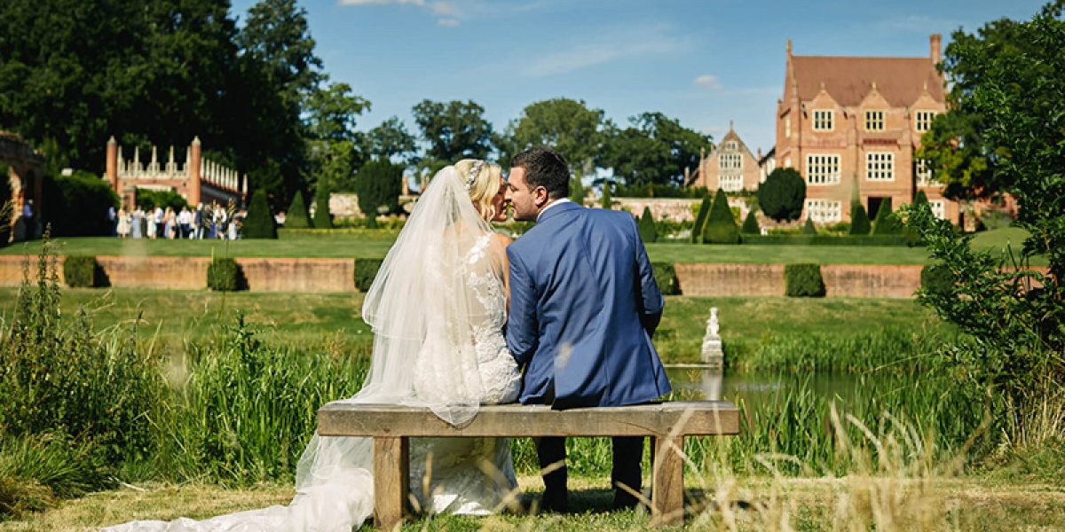 A couple taking a moment in the gardens at Oxnead Hall wedding venue in Norfolk | CHWV