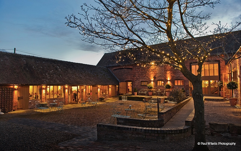 Curradine Barns courtyard at night