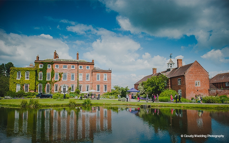 Delbury Hall with it's grounds and lake in Shropshire