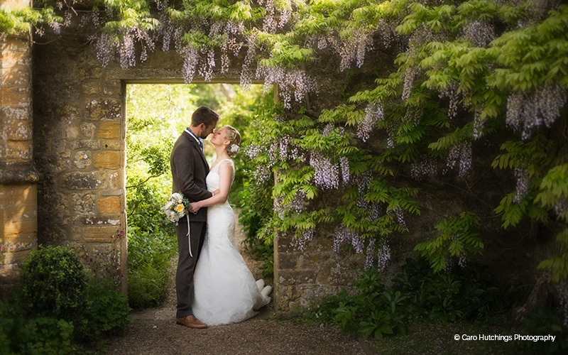 Couple in the Grounds of Lains Barn - Barn Wedding Venue in Oxfordshire