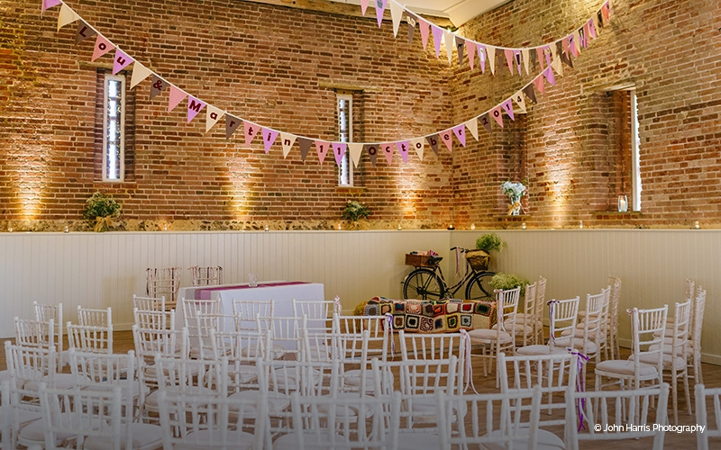 The impressive Great Barn at Manor Mews ready for a ceremony - Barn Wedding Venue in Norfolk