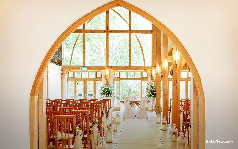 The Ceremony Barn is a romantic setting to exchange wedding vows. Floor to ceiling glass windows look out onto the gardens