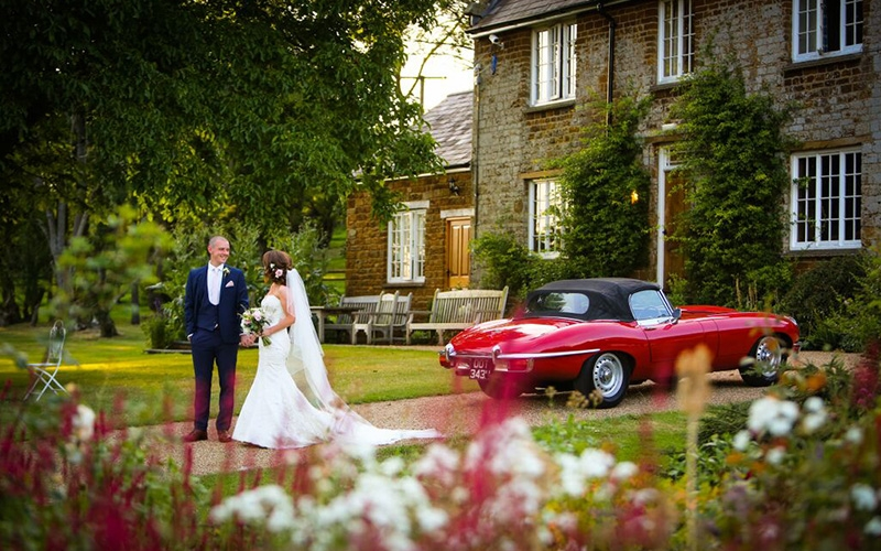 A Happy Couple Outside Crockwell Farm In Northamptonshire Venues