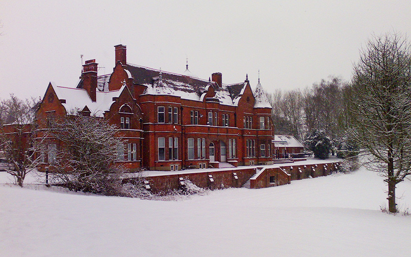 Robert Denholm House wedding venue in Surrey surrounded by snow | CHWV