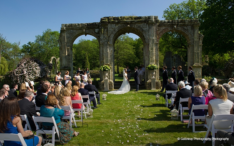 An outdoor wedding ceremony at Slaugham Place