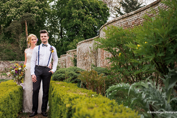 A couple taking a moment in the beautiful walled garden at Syrencot barn wedding venue in Wiltshire | CHWV