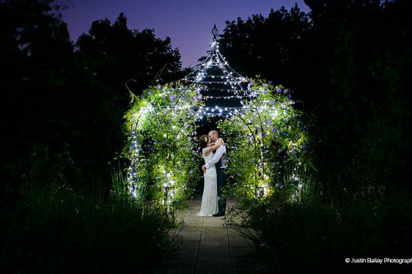Happy couple beneath the Walled Garden Pavilion
