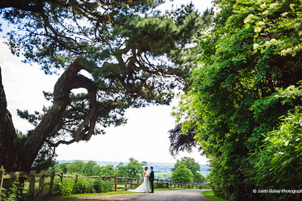 Wedding couple in the grounds of Gaynes Park