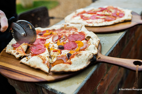 Wood fired pizza from Galloping Gourmet at Blackwell Grange barn wedding venue in Warwickshire | CHWV