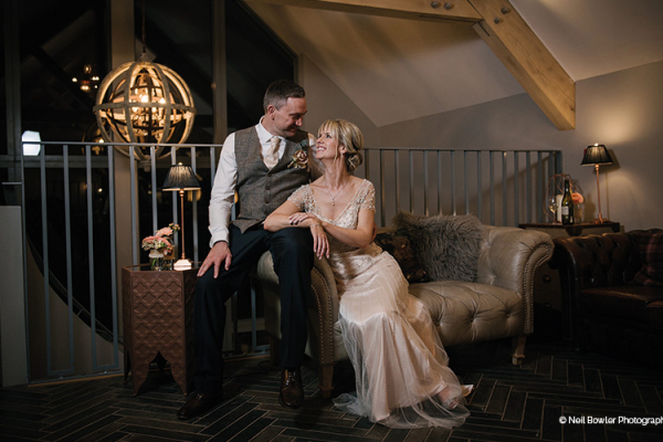 A couple take a moment in the Snug at Blackwell Grange barn wedding venue in Warwickshire | CHWV