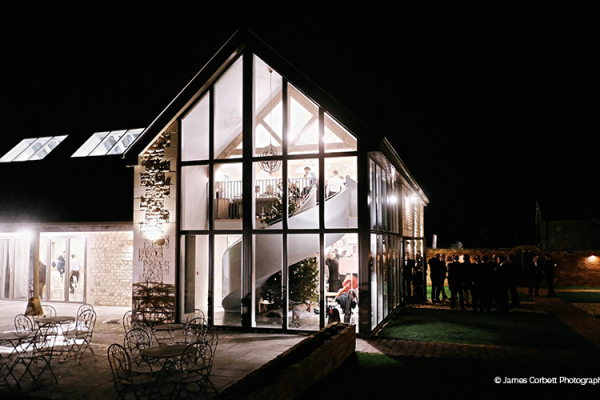 The Orchard Barn in the evening at Blackwell Grange barn wedding venue in Warwickshire | CHWV