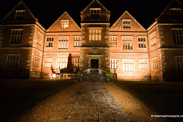 Breamore House, Country House Wedding Venue in Hampshire, all lit up at night time