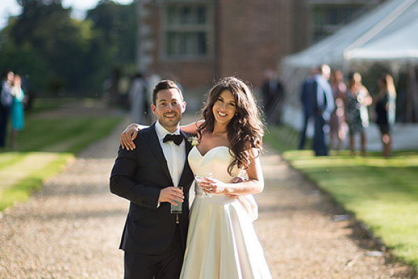 A happy couple celebrating their wedding at Breamore House in Hampshire