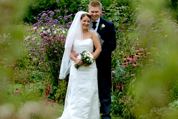 Happy couple in the grounds at Burton Court