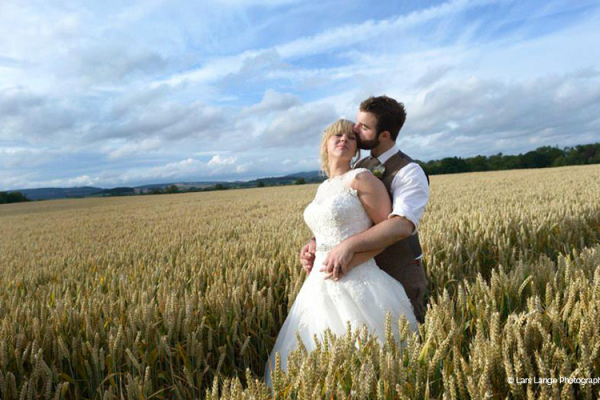 A happy in the field at Burton Court wedding venue in Herefordshire | CHWV