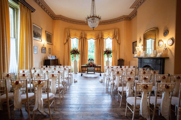 The Regency Room set up for a ceremony at Burton Court wedding venue in Herefordshire | CHWV