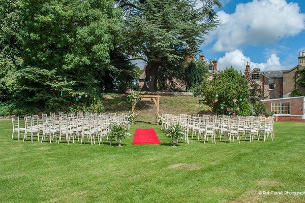 Set up for an outdoor wedding ceremony at Burton Court wedding venue in Herefordshire | CHWV