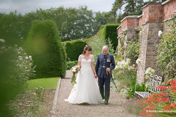 A couple taking a moment in the beautiful gardens at Burton Court wedding venue in Herefordshire | CHWV