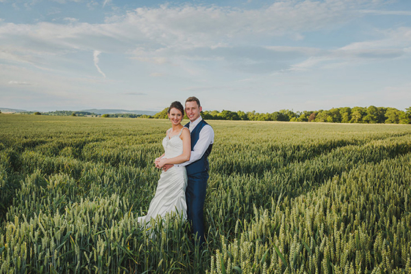 A couple taking a moment in the corn fields at Burton Court wedding venue in Herefordshire | CHWV