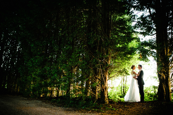 A couple take a moment in the forest at Clearwell Castle wedding venue in Gloucestershire | CHWV
