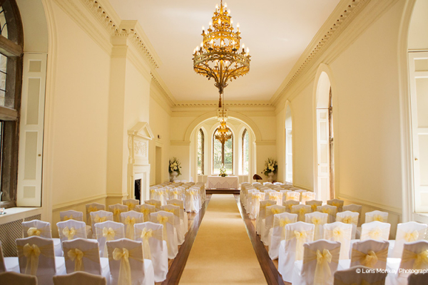 Set up for a wedding ceremony in the ballroom at Clearwell Castle wedding venue in Gloucestershire | CHWV