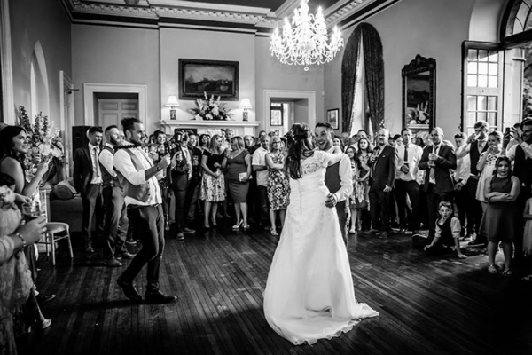 Romantic first dance in the Main Hall at Clearwell Castle wedding venue in Gloucestershire | CHWV