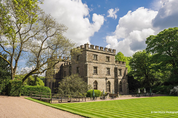 The castle and green lawns at Clearwell Castle wedding venue in Gloucestershire | CHWV