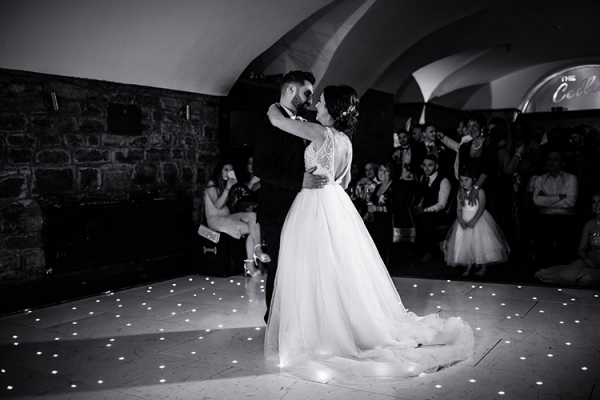 Romantic first dance in the Vaulted Cellar Bar at Clearwell Castle wedding venue in Gloucestershire | CHWV