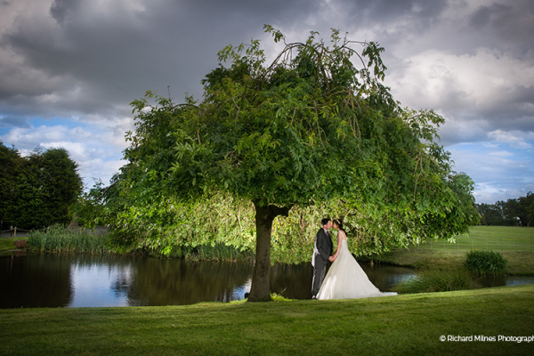 A couple taking a moment in the beautiful grounds at Colshaw Hall wedding venue in Cheshire | CHWV
