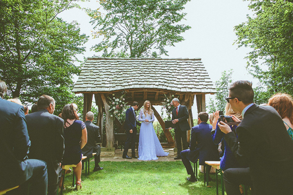 An outdoor wedding ceremony at Cripps Barn wedding venue in Gloucestershire | CHWV