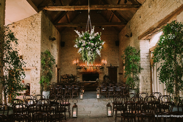 Set up for a wedding ceremony at Cripps Barn wedding venue in Gloucestershire | CHWV
