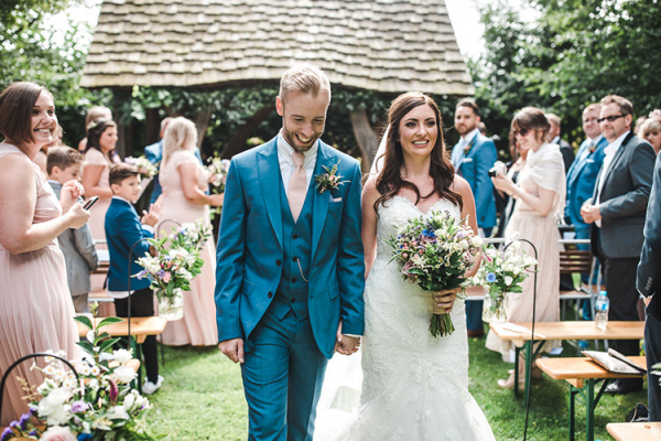 Just married in an outdoor wedding ceremony at Cripps Barn wedding venue in Gloucestershire | CHWV