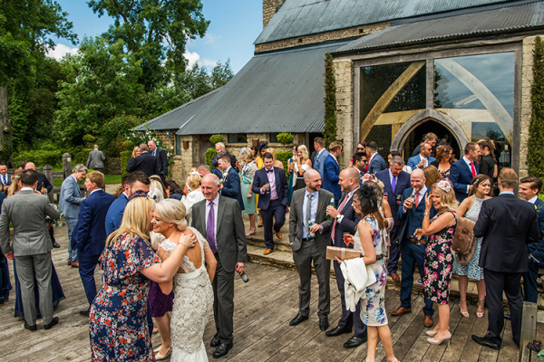 A drinks reception in the beautiful grounds at Cripps Barn wedding venue in Gloucestershire | CHWV