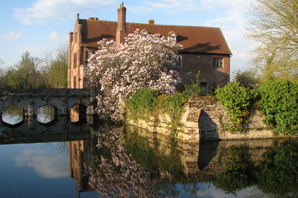 Crows Hall surrounded by it's moat and bridge