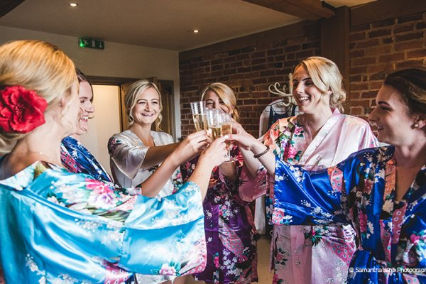 Bride and her bridesmaids getting ready at Curradine Barns wedding venue in Worcestershire | CHWV