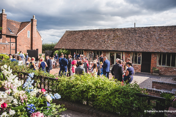 Drinks reception in the courtyard at Curradine Barns wedding venue in Worcestershire | CHWV
