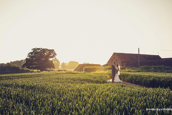 A couple taking a moment at Curradine Barns wedding venue in Worcestershire | CHWV