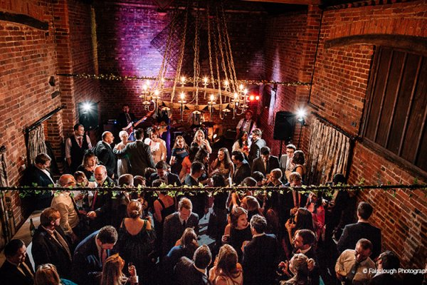 Full dancefloor at an evening reception at Curradine Barns wedding venue in Worcestershire | CHWV